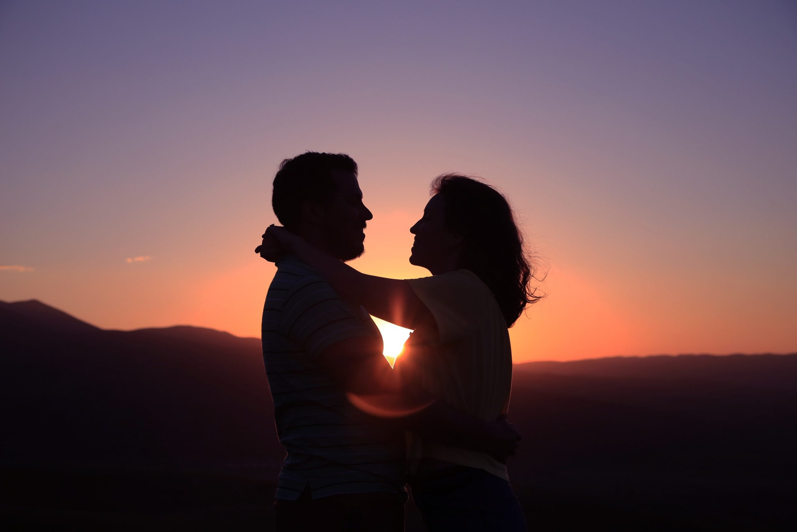 a happy couple at sunset